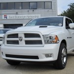 two white Dodge Rams